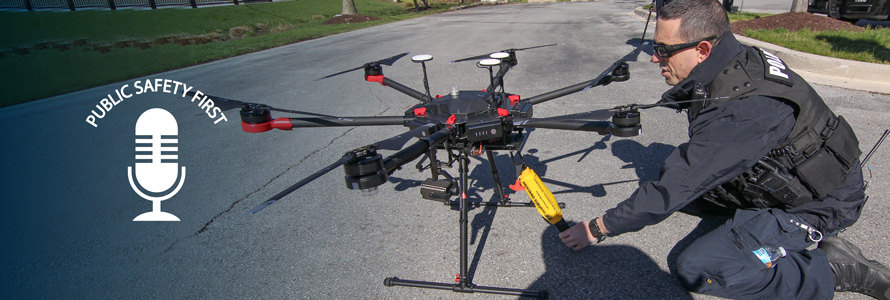 """Police officer prepares drone on street; Public Safety First podcast logo; """"Eyes in the Sky: Drones and FirstNet"""""""