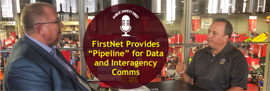 """FirstNet Authority Senior Public Safety Advisor Gary McCarraher sits across from Chief Charles Doody of the Canton (MA) Fire Department with fire expo displays in background; Public Safety First podcast logo; """"FirstNet Provides """"Pipeline"""" for Data and Interagency Comms"""""""