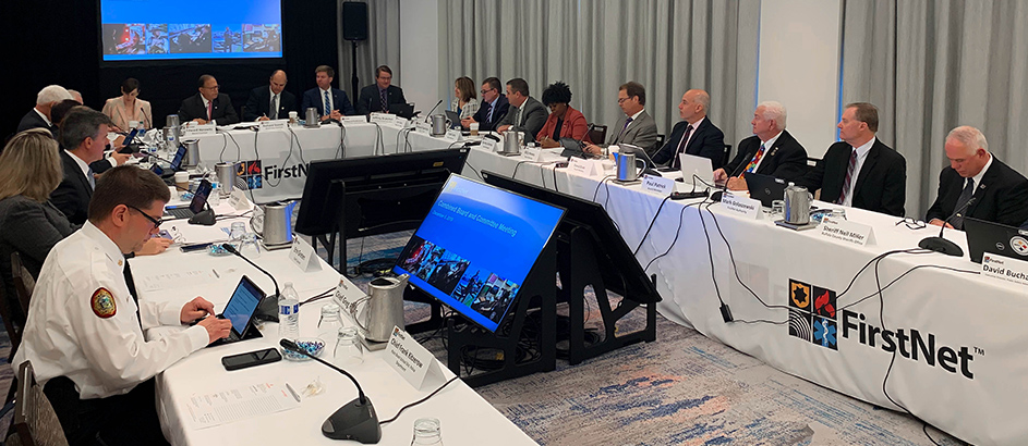 FirstNet Authority Board sits at tables facing each other while discussing agenda at December 2019 meeting
