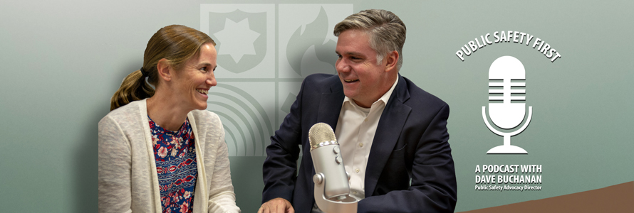 Host Dave Buchanan interviews Amanda Hilliard in front of a microphone on a table