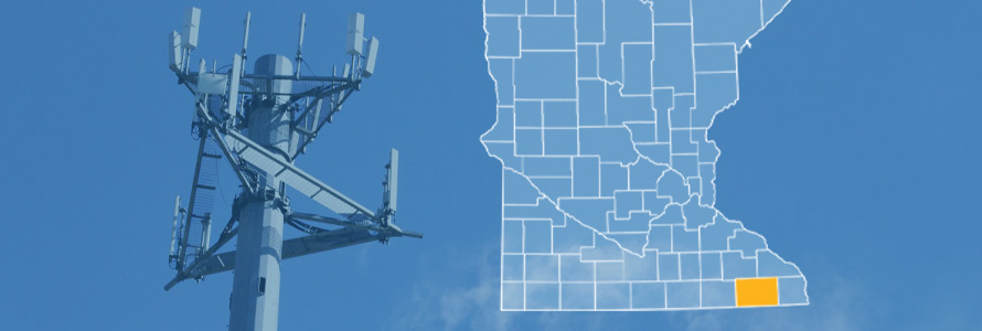 The state of Minnesota, with outlined county borders and Fillmore County highlighted; a cell tower