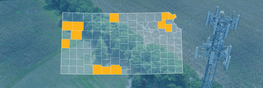 The state of Kansas, with outlined county borders; a cell tower.