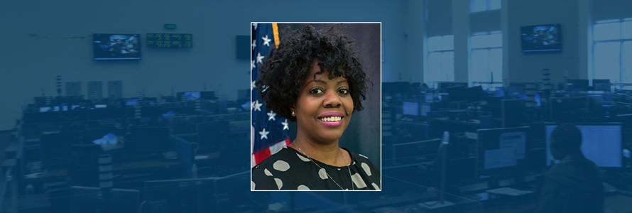 Karima Holmes headshot; Emergency communication center
