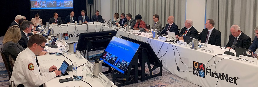 Photo of FirstNet Authority Board members sitting around a table during a meeting.
