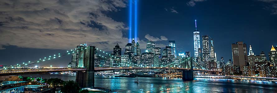 New York City skyline with two beams of light in the sky marking September 11 remembrance
