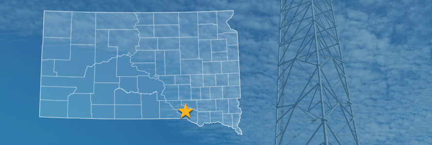 The state of South Dakota, with outlined county borders and a star locating Yankton Sioux Reservation, South Dakota; a cell tower.