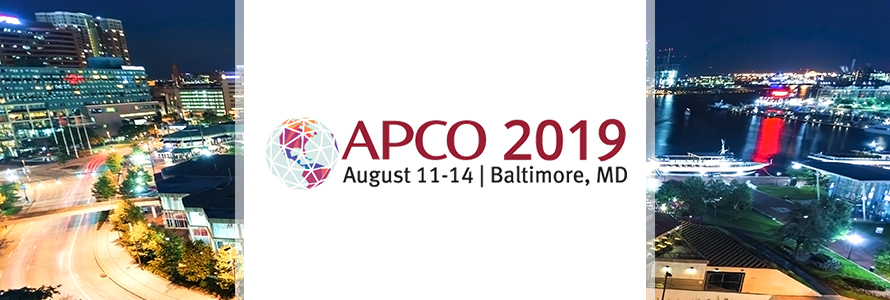 "The APCO 2019 logo over the Baltimore skyline with the words ""August 11-14, Baltimore Maryland"""
