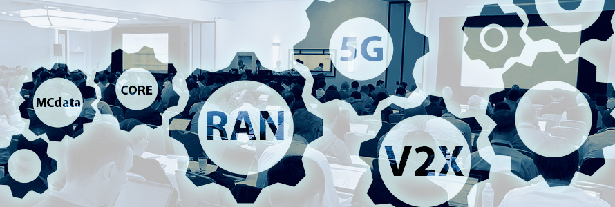 """Photo of a 3GPP meeting room with people sitting at tables and working on computers, overlaid with gear icons and wireless network terminology: RAN, 5G, V2X, Core, MCdata."""""""