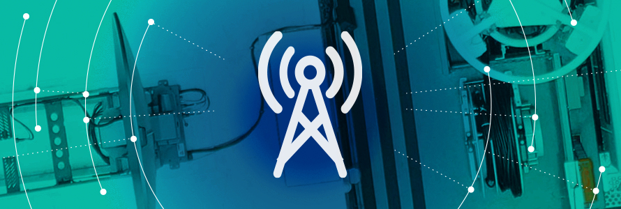 Roadmap Coverage and Capacity Domain icon (a broadband tower), surrounded by a graphic representation of a network radiating out, over an aerial view of a FirstNet SatCOLT