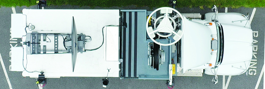An aerial view of a Satellite Cell on Light Truck (SatCOLT) sitting in a parking lot.