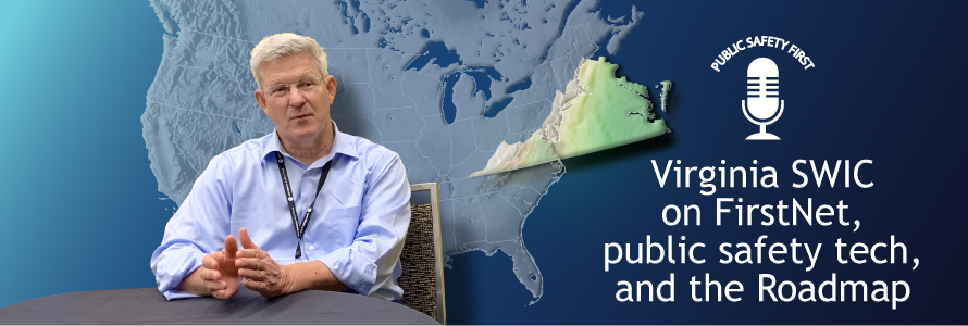 Man sitting at a table with a map of the United States and enlargedColor outline topographic map of the state of Virginia behind him on a blue background
