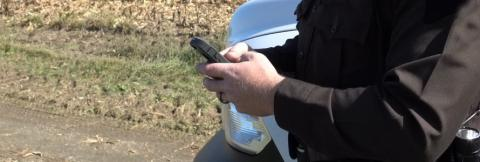 First responder holding a cell phone