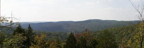 View of forest and hazy sky from Bell Mountain