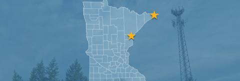 The state of Minnesota, with outlined county borders and two stars locating Cloquet and Hovland, Minnesota; a cell tower.