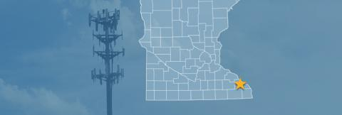 The state of Minnesota, with outlined county borders and a star locating Lewiston, Minnesota; a cell tower.