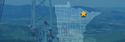 The State of Minnesota, with outlined county boarders and a star; a cell tower