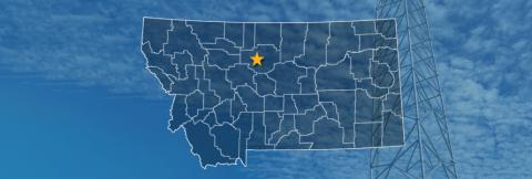 The state of Montana, with outlined county borders and a star locating cell site; a cell tower.