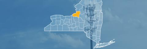 The state of New York, with outlined county borders; a cell tower.