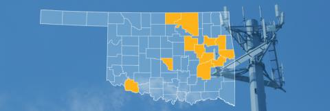 The state of Oklahoma, with outlined county borders; a cell tower