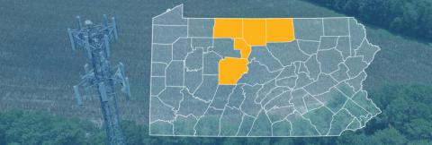The state of Pennsylvania, with outlined county borders; a cell tower.