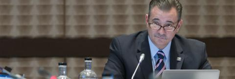 Chief Richard Carrizzo speaks into a microphone at a FirstNet Authority Board meeting
