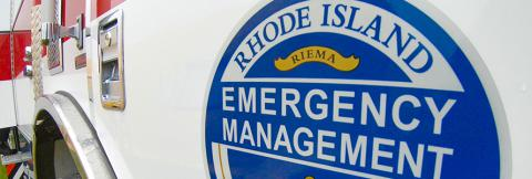 The Rhode Island Emergency Management Agency logo on a truck.